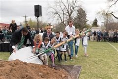 "Denver Academy (DA) Headmaster Mark Twarogowski (far left), ""Pelicans"" (DA's youngest students, grades 1 to 3), Board Member Steve Lockton (center), and Board Member/DA Alumnus Dylan Geller '92 (right) break ground on the school's new Athletic Facility during a ceremony on May 1, 2018. The ceremony also celebrated the launch of the school's Elementary/6th Grade Building renovation."
