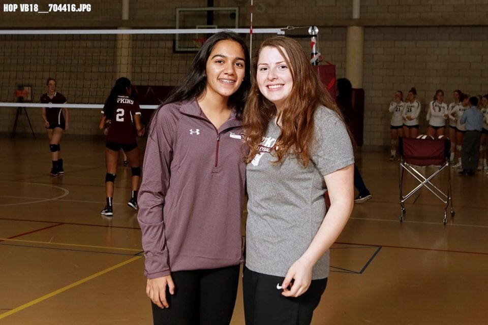Casey Goldberg '20 cheers on her team at a volleyball game with Diya Aggarwal '22.