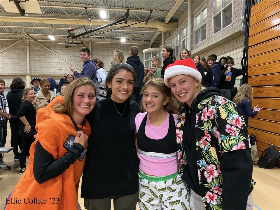 Jenny Alaska '22, Dixie D'Amelio, Sofia Karatzas '22, and Ellie Collier '23 pose at the Volleyball FAA Finals Game between Hopkins and King.