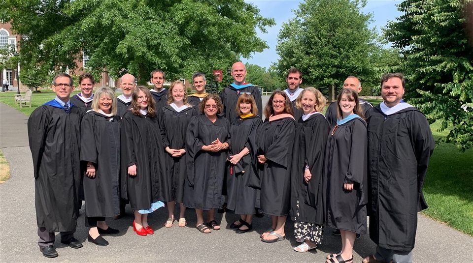 Jacox with the English Department  at the Class of 2019 graduation. Credit: Alex Werrell