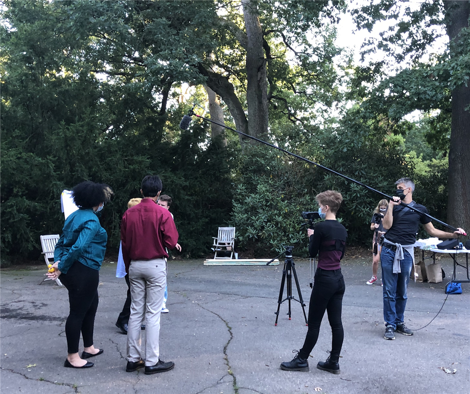 Actors at a dress rehearsal for Actions Outlive Us, with director Margaret Toft '21 standing center and Ian Melchinger and Ella Norwitt '21 serving as film crew. Photo Credit: Zach Williamson '22