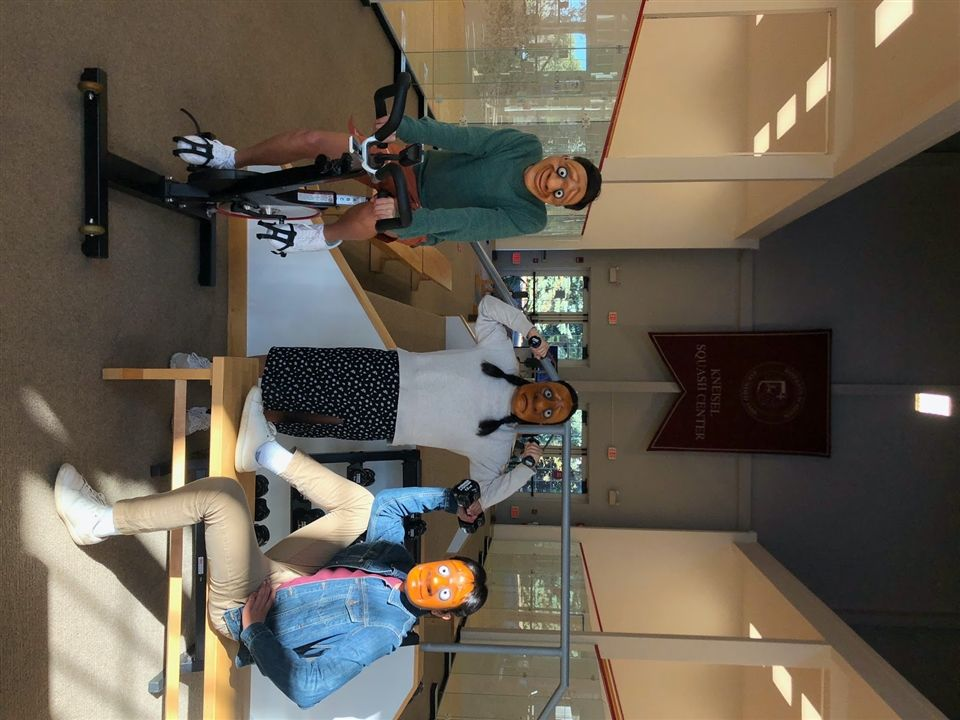 "Drew Slager '21, Rhea Ahuja '23, and Anand Choudhary '22 pose for a photo in their masks from ""Boxes."""