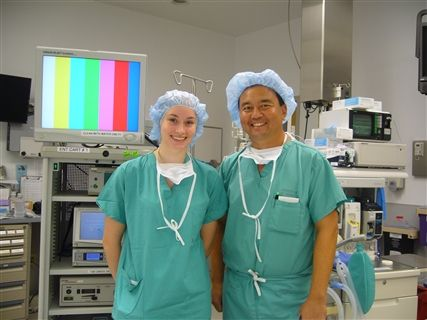 Dr. Ken Yanagisawa '79, otolaryngologist, with Eliza Prangley '10 during a job shadow program visit