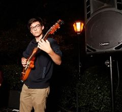 Bennett Daponte-Smith '16 plays guitar at Back To School Bash in  September with his band. (photo: Peter Mahakian)