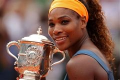 Serena Williams poses with one of her 21 Grand Slam Trophies. (photo: brightlifego.com)