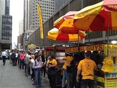 Many New Yorkers wait in line at the Halal Guys for a taste of the Middle Eastern fare (lifeaboardthetravelingcircus.com).