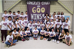 The Hopkins Swim Team poses in front of Elrick's 600 Wins banner.  photo credit: Peter Mahakian
