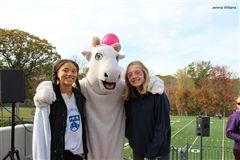 The Goat mascot poses with Hopkins students.
