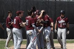 The Boys Baseball Team celebrates a home run at a game in 2016.