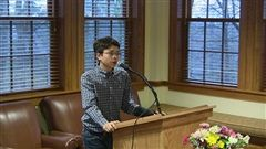 Burton Lyng-Olsen '20 reciting his poem at the annual Celebration of Poetry.