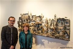 "Syrian artist and architect Mohamad Hafez and Chair of the Art Department Karen Klugman stand in front of ""The Ruler of the Land."""