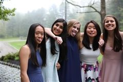Freshmen take a moment to huddle before the Sadie Hawkins Dance.  Left to right: Olivia Wen, Saira Munshani, Mika Kendall, Zoe Kim, Sarah Roberts