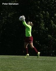 Goalkeeper Jess D'Errico makes a save during Hopkins' win over rival Hamden Hall