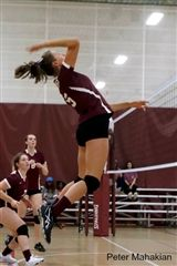 Speer setting up for a serve during a home game against Saint Luke's