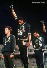 Tommie Smith and John Carlos raise fists during the National Anthem at the 1968 Olympics.