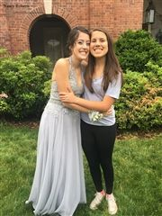 Sarah Roberts '20 and Naomi Roberts '18 pose before prom.