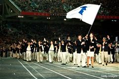 Korean athletes march under the Korean Unifcation Flag at the 2000 Olympic Games in Sydney, Australia. This fag will appear again this year in the 2018 Olympic Games.