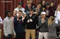 The Hopkins Fan Club proudly cheers at a home basketball game against Greens Farms Academy.