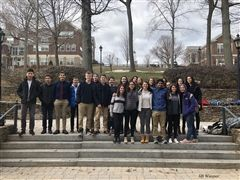 Members of Hopkins Model UN gather in front of Baldwin Hall.