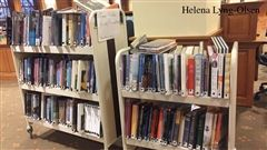 Former library books can be taken home from carts such as this one.