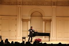 Mark Xu '18 soloing at Carnegie Hall in 2015 as the winner of the American Protégé International Concerto Competition.