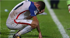 Christian Pulisic of the USMNT holds his head in disbelief after a shocking loss to Trinidad and Tobago.