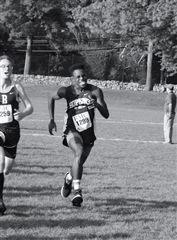 Michael Christie '19 kicks into the finish line at the Brunswick FAA meet.
