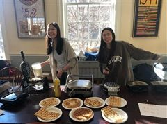 Lauren Seto '19 and Ashley Chin '19 sell waffles for the Connecticut Food Bank.