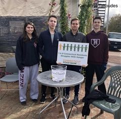 Katherine Takoudes '20, Simon Asnes '20, Alex Schuster '20, and Tomas Gordon '20 fundraise outside Romeo and Caesar's.