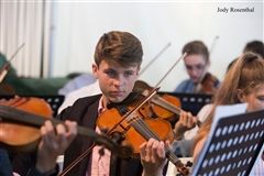 Teddy Glover '21 plays at Commencement in 2018.
