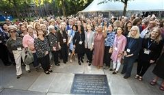 Yale alums pose with the stone honoring coeducation during the Commemorative Weekend on September 21