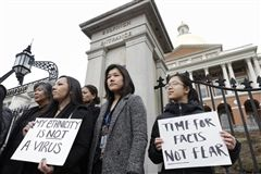 On March 12, 2020, Asian-Americans in Boston protested against discrimination arising from Coronavirus. Photo by Steven Senne