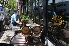 Connecticut restaurant owner Bob Cooke sets up outdoor dining areas in preparation for the reopening of his restaurant. Credit: Cloe Poisson