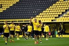Borussia Dortmund forward Erling Haaland celebrates a goal for the first time without fans in the stadium.