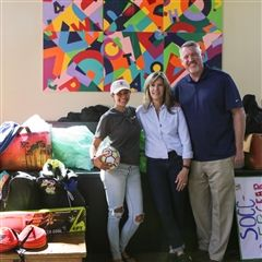 Marina Lesse '09, Dean of Campus Life Rick Duque, and Director of Parent Relations and Special Events Anne Stewart with items collected for Houston.