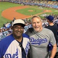 Rahmi Mowjood '90 and Kyle Smart '92 at Game 1.