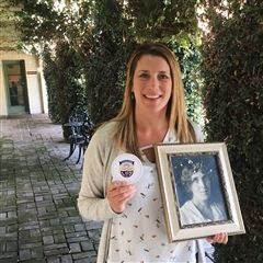 VWS Dean of Students Sarah Lantz holds a portrait of Vivian Webb