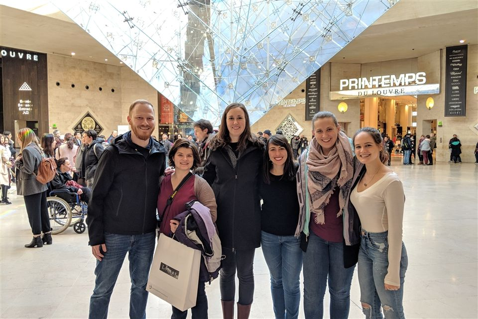 Tess M. '18 caught up with Grier teachers and classmates in Paris, France.  Mr. Packnick, Mrs. Woolfrye, Mme. Pope, Srta. Leen, and Ms. Kitty Moyer meet Tess at the inverted pyramid of the Louvre entrance.