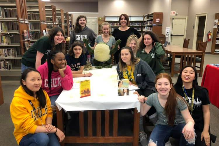 "Cast members of ""Tuck Everlasting"" with Musical Director Mrs. Reinhardt.  Grace A, Ashley S, Alex H, Clara G, Petralinda M, Debbie G, Liza E, Michelle C, Erzsi M, Hannah N, and Lillian R."