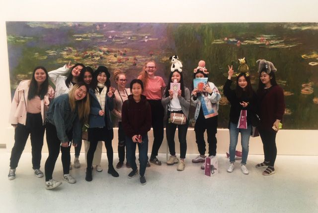 "The group of AP Art Portfolio students in front of a Monet ""Waterlilies"" painting in the Carnegie Museum of Art.  The group included Aviva B, Miranda H, Judy J, Yenny S, Abby T, Grace H, Chaewon L, Rona W, Dora K, Jessica K, Courtney M, Vivien Z, and Monica U."