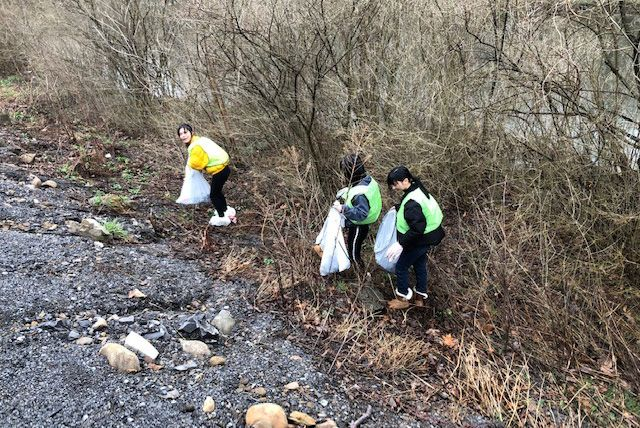 Grier students pick-up trash that has washed down the Little Juniata River and collected on the riverbanks.