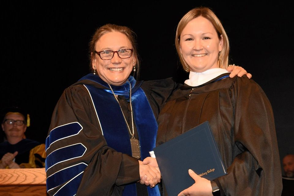 The President of Middlebury College with Ms. Barr.
