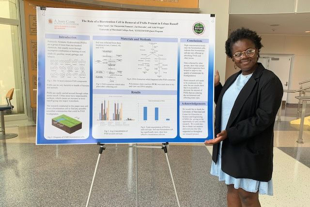 Zai with a presentation at the University of Illinois.