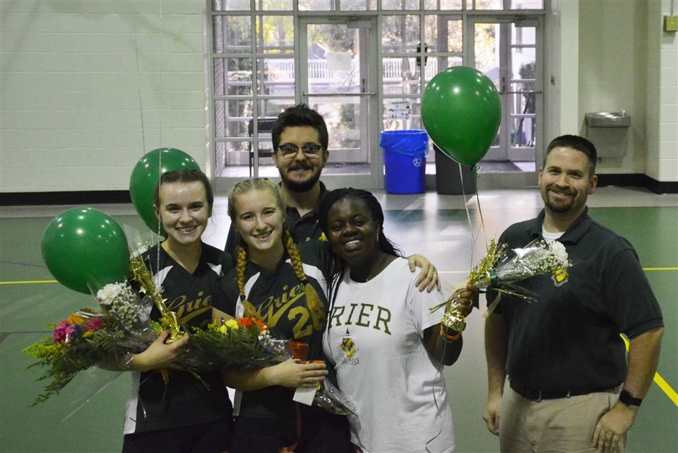 Coach Ort and Assistant Coach Beckel with the Varsity Volleyball seniors Shelby, Payton, and Zai.