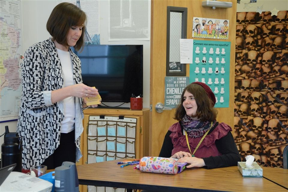 Mme. Pope plays French trivia with Lillian and other students at Extra Help during National French Week.