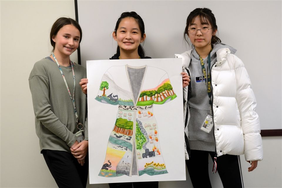 Lexi, Stella, and Catrina with their Singer's robe project for English 7 Honors.