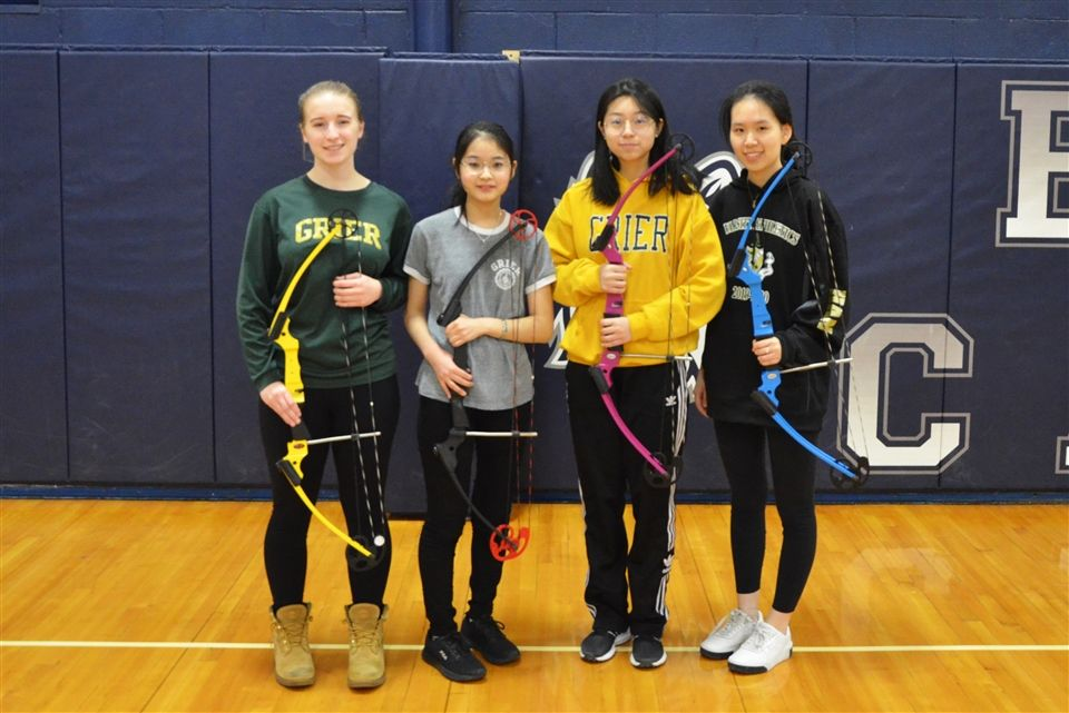 Payton, Nodoka, Judy, and April compete at the NASP State Qualifying Archery Tournament at Bishop Carroll School.