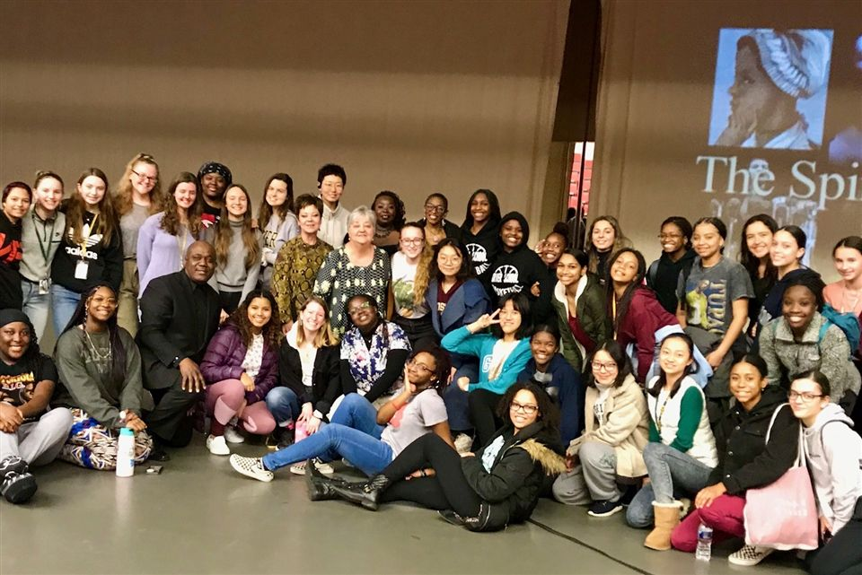 Members of Key Arts Productions gather for a group photo with Grier students after the lively production.