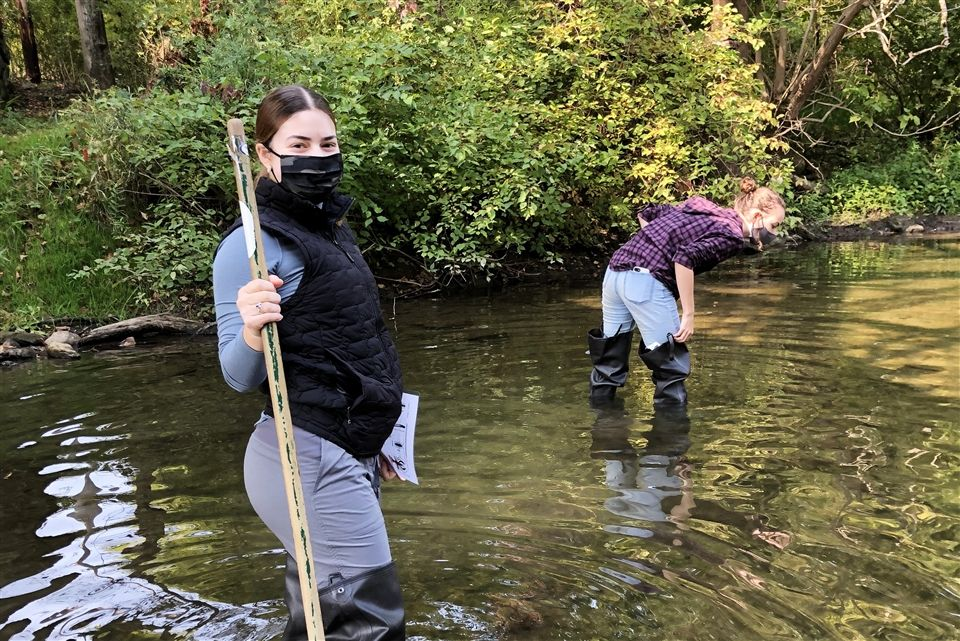 Natalia and Julia with waders in the Little Juniata River.
