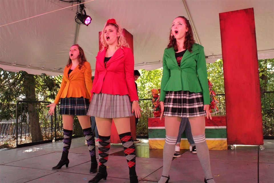 "Charlotte (center) in red, plays the starring role of Heather Chandler in a Pelham. NY, production of ""Heathers: the Musical."""